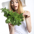 Woman with green salad leaves — Stock Photo #28904321