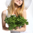 Woman with green salad leaves — Stock Photo #28904363