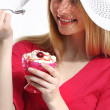 Stock Photo: Cute womwith dessert