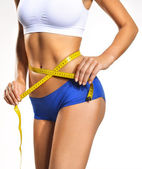 Woman measuring her waistline. Perfect Slim Body. Diet — Stock Photo