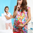 Pregnant woman with her daughter — Stock Photo