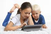Children look tablet — Stock Photo
