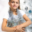 Girl with Christmas present — Stock Photo #30666899