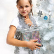Girl with Christmas present — Stock Photo #30666955