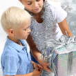Sister gives her brother a Christmas gift — Stock Photo