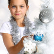 Girl dresses up Christmas tree — Stock Photo #30667339