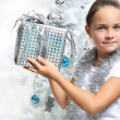 Girl with Christmas present — Stock Photo #30667361