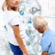 Brother and sister decorate the Christmas tree — Stock Photo