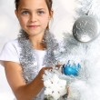 Girl dresses up Christmas tree — Stock Photo #30676137