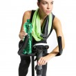 Girl in a black sweat suit riding a bike and drinking water — Stock Photo