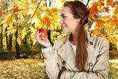 Autumn woman with apple — Stock Photo