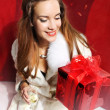 Lady with red gift and champagne  — Stock Photo
