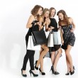 Group of girls looking at shopping — Stockfoto