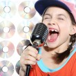 Stock Photo: Singing girl in orange cap