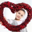Cute Caucasian girl holding a red Valentine heart — Stock Photo