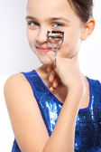 Girl with eyelash curler for overclocking — Stock Photo