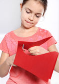 Child cut from red paper heart — Stock Photo