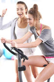 Training on exercise bike — Stok fotoğraf