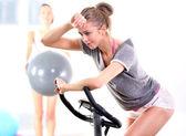 Training on exercise bike — Stock Photo