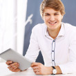 Working behind a desk, a handsome young employee — Stock Photo