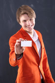 Portrait of energetic man with a white showcase — Stock Photo