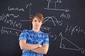 Student at the blackboard — Stock Photo