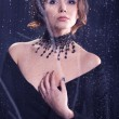 Glamour necklace-portrait of a woman in black — Stok fotoğraf