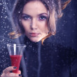Woman with a glass of red wine — Stock Photo #40213617