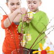 Family Easter- children decorates Easter eggs — Stock Photo