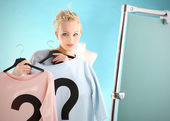 Shopping dilemmas - a woman in dressing room . — Stock Photo