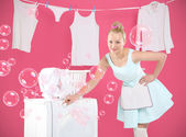 Laundry , hanging , sorting -  happy woman leads home. — Stock Photo