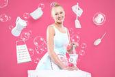 Retro housewife in the kitchen - feminine duties. — Stock Photo