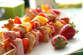 Tasty fruit skewers — Stock Photo