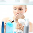 Cosmetic shopping - woman reading label — Stock Photo #46672075