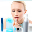 Shopping frenzy - a woman in a cosmetic shop. — Stock Photo #46672123