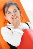 Tired child - girl reading a book — Stock Photo