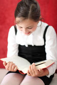 Interesting reading - girl reading a book — Stock Photo