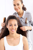 African woman at the hairdresser — Stock Photo