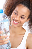 Mulatto is drinking water. — Stock Photo