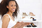 Sport shoes, sneakers girl buys — Stock Photo