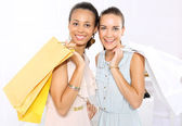 Successful shopping, women with shopping bags  Friends of paper shopping bags — Stock Photo