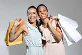 I love shopping! Women with shopping bags — Stock Photo