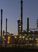 An oil refinery at sunset — Stock Photo