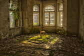 Old chair in an abandoned dilapidated house — Stok fotoğraf