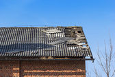 Damaged tile on the roof — Stock Photo