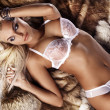 Fashionable photo of young blonde woman wearing white lingerie - Foto de Stock