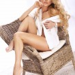 Photo of beautiful blonde lady posing, sitting on chair. — Stock Photo