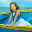 Little cute girl in a boat on the beach, vacation day. — Stock Photo