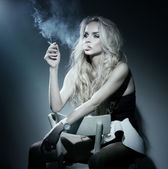 Portrait of blonde lady with cigarette in hand thinking. — Stock Photo