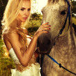 Portrait of gorgeous blonde girl with horse. — Foto de Stock